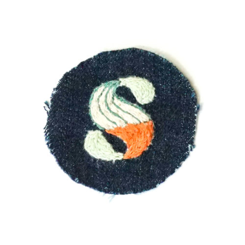 embroidered letter S, color blocked with mint, and orange